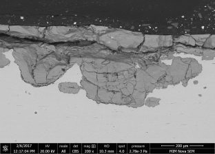 Magnified view of the thick iron oxide later lining the portion of the crack